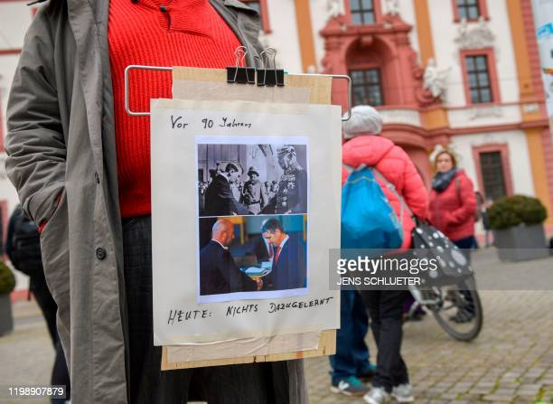 One day after the election of Thuringia's State Premier a man protests with a placard reading 90 years ago Today nothing learned from it showing a...