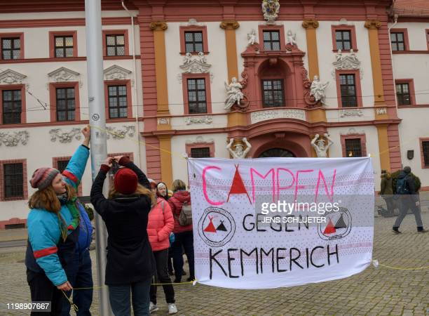 One day after the election of Thuringia's State Premier people hang a placard reading Camping against Kemmerich during a protest in front of the...