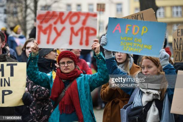 One day after the election of Thuringia's State Premier young people hold placards reading Not my MP and A FD P When the cut quantity is true during...