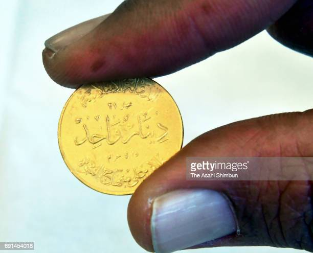 A One Dinar gold coin issued by the Islamic States is seen on May 31 2017 in Mosul Iraq