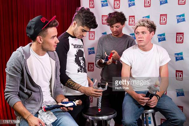 One Direction band members Liam Payne Zayn Malik Louis Tomlinson and Niall Horan on stage at the One Direction Private Concert Fan Chat Hosted by...