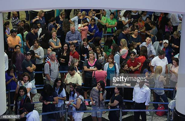 One Direction fans line up outside Virgin Megastore, Mall of the Emirates, from the early hours to buy tickets for the One Direction Dubai Concert,...