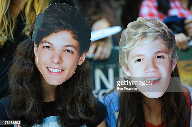 One Direction Fans wearing One Direction masks camp in Leicester Square ahead of the bands London Premiere for 'This Is Us' on August 19 2013 in...
