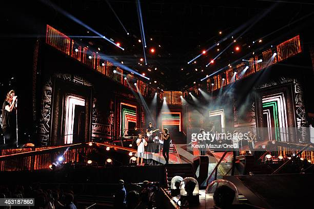 """One Direction performs onstage during the """"Where We Are"""" tour at Met Life Stadium on August 4, 2014 in New York City."""