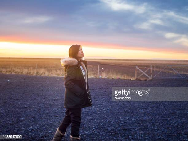 one east asian women walking on remote location iceland. - individual event stock pictures, royalty-free photos & images
