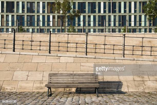 One empty seat on promenade near Spree River in Berlin (Germany)