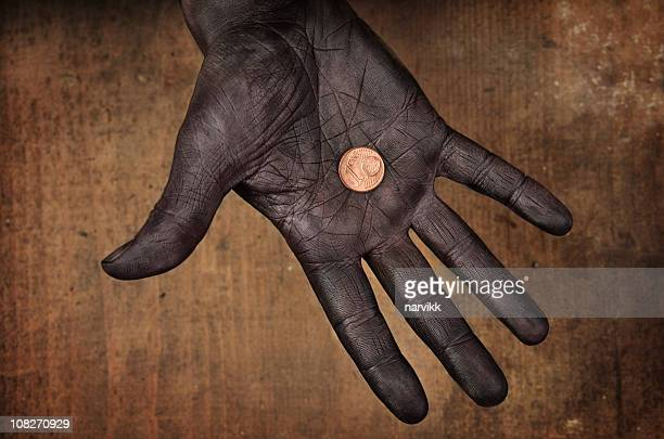 One Euro Cent Coin in Human Hand