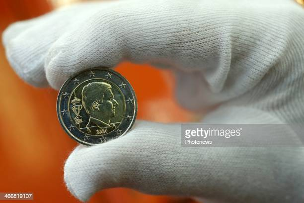 One Euro coin bearing King Philippe's effigy is presented on February 4 , 2014 in Brussels, Belgium.