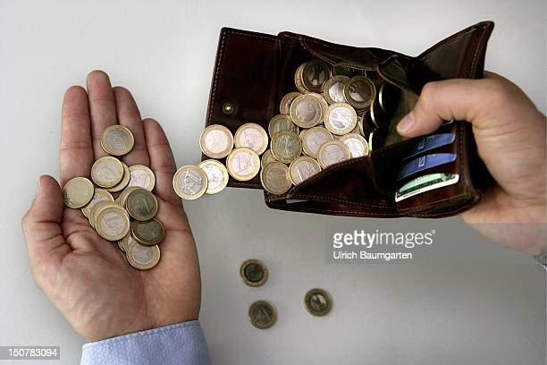 One Euro coins in a purse