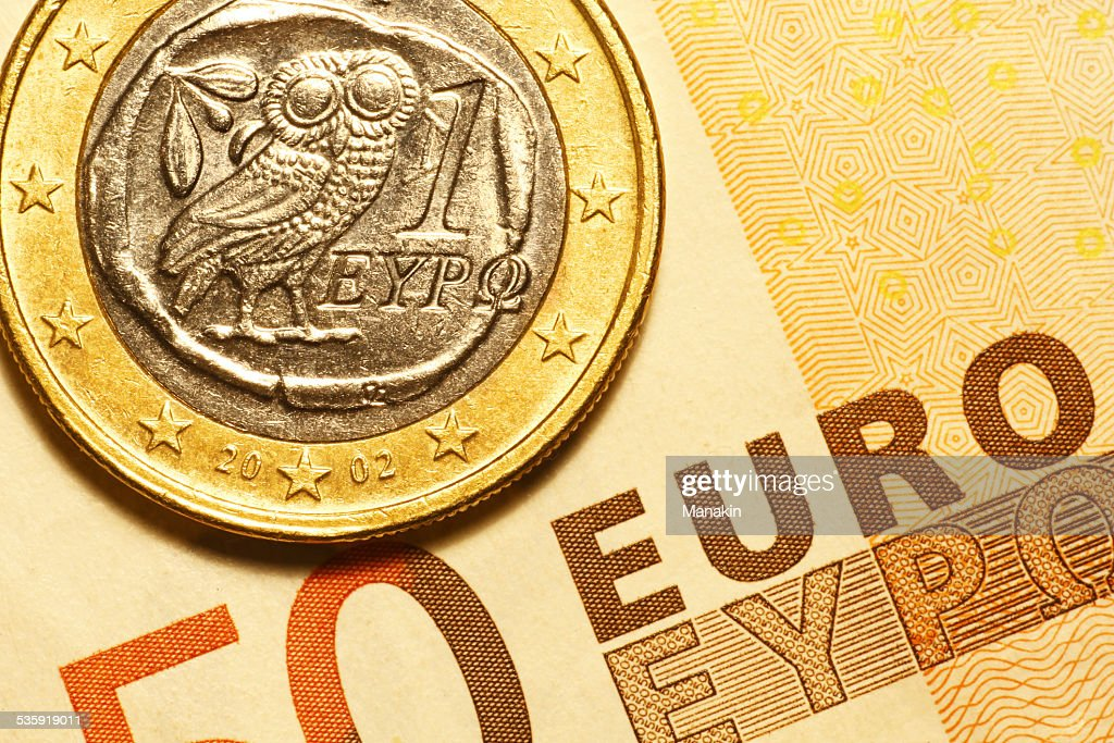 One euro greek coin and 50 euro banknote : Stock Photo