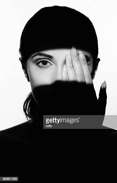 one eye - hands covering eyes stock pictures, royalty-free photos & images