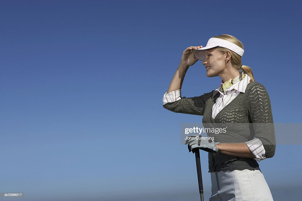 One Female Golf Player Looking Ahead : Stock Photo