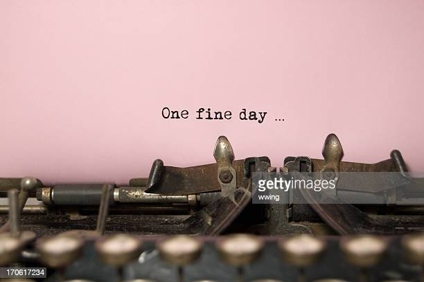 one fine day....on antique typewriter - authors stock photos and pictures
