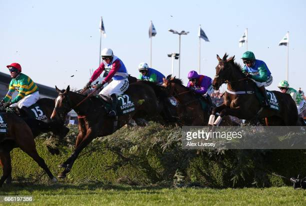 One For Arthur ridden by Derek Fox clears the Water Jump on their way to victory in the 2017 Randox Health Grand National at Aintree Racecourse on...