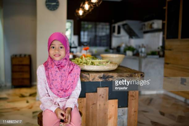 one girl sitting in living room - ramadan decoration stock pictures, royalty-free photos & images