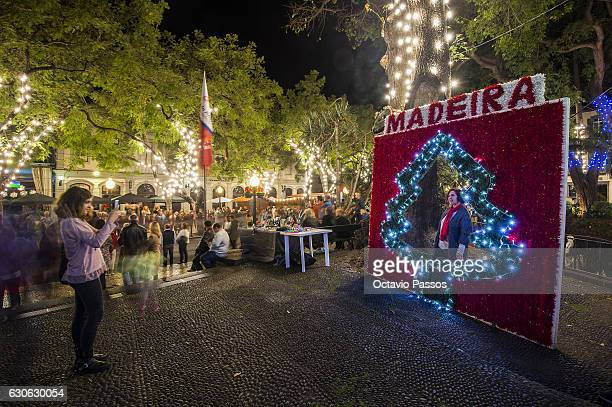 One girl take a picture in the Christmas city lights on December 29, 2016 in Funchal, Madeira, Portugal.
