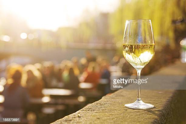 One glass of wine in a sidewalk cafe
