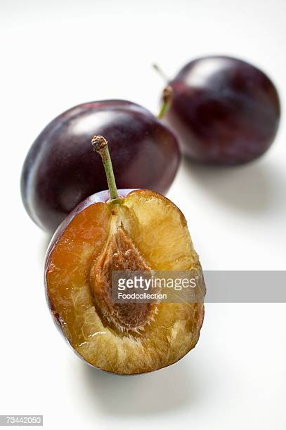 One half and two whole damsons