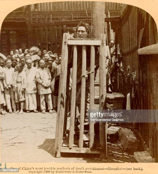 One half of a stereo view showing a form of public execution in Shanghai China is produced by Underwood Underwood in New York City in 1900 The death...