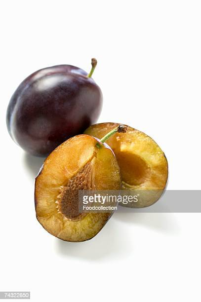 One halved and one whole damson