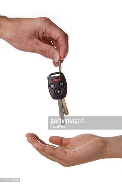 One hand dropping the car keys into another