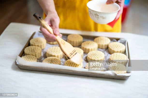 one hand is making moon cakes - moon cake stock pictures, royalty-free photos & images