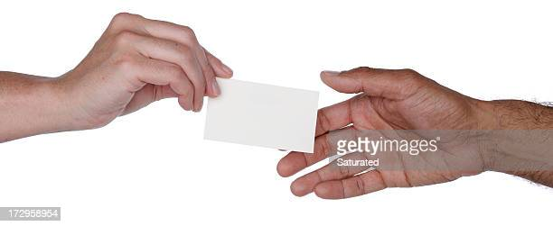 one hand passing a blank business card to another - passing giving stock photos and pictures
