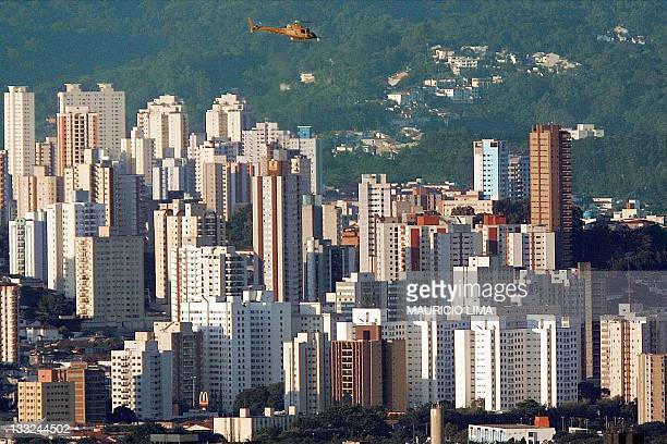 One helicopter overflights the north of Sao Paulo Brazil 20 December 2001 In Sao Paulo the Brazil's economic capital helicopters are the latest...
