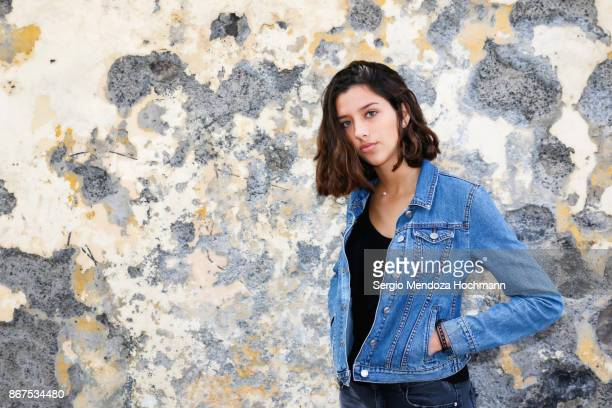 one hispanic teenage girl posing in front of a weathered wall in mexico city, mexico - denim jacket stock pictures, royalty-free photos & images