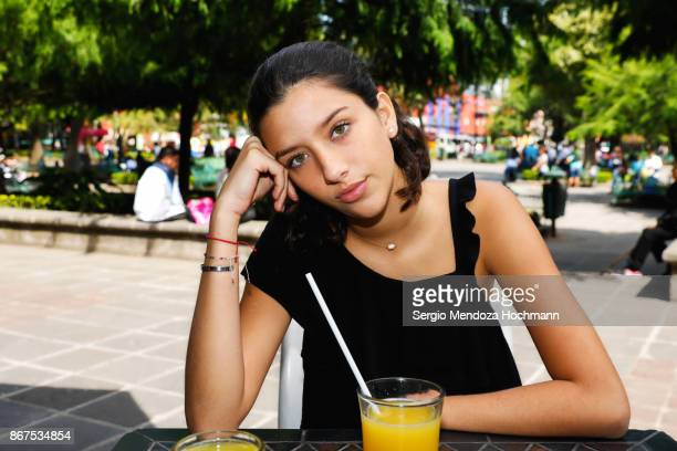 One hispanic teenage girl sitting down in Mexico City, Mexico