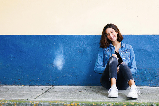 One hispanic teenage girl sitting on the floor in Mexico City, Mexico - gettyimageskorea