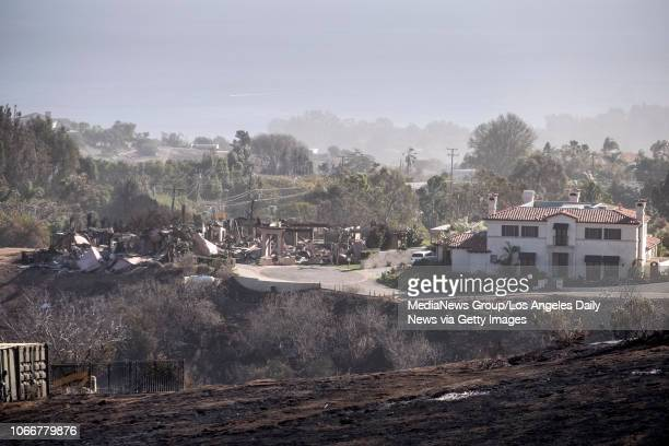 One home remains standing while it's neighbor is totally destroyed from the path of the Wolsey fire near Kanan Dume road in Malibu