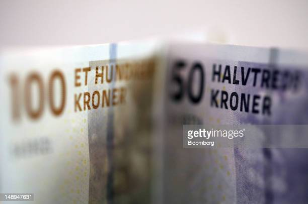 One hundred and fifty Danish kroner currency notes are seen in this arranged photograph in London UK on Friday July 20 2012 Demand for Danish kroner...