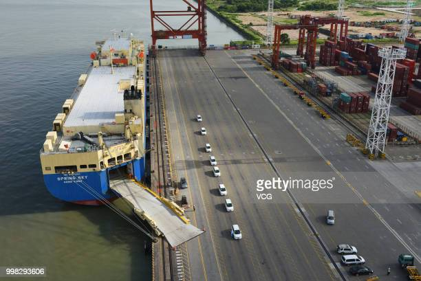 One hundred BYD e6 automobiles are exported from Shenzhen to Thailand by rollon/rolloff ships at Dachan Bay Terminals on July 12 2018 in Shenzhen...