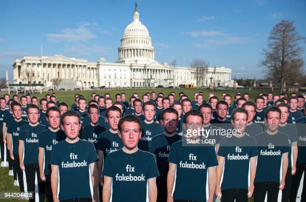 One hundred cardboard cutouts of Facebook founder and CEO Mark Zuckerberg stand outside the US Capitol in Washington, DC, April 10, 2018. - Advocacy...