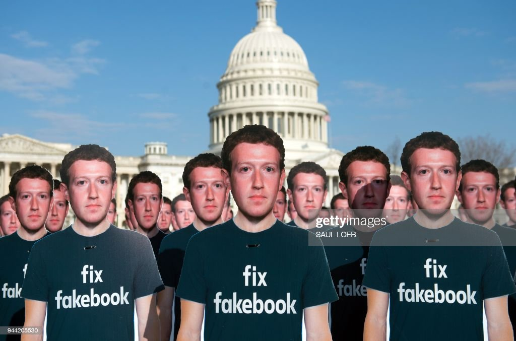 One hundred cardboard cutouts of Facebook founder and CEO Mark Zuckerberg stand outside the US Capitol in Washington, DC, April 10, 2018. - Advocacy group Avaaz is calling attention to what the groups says are hundreds of millions of fake accounts still spreading disinformation on Facebook.