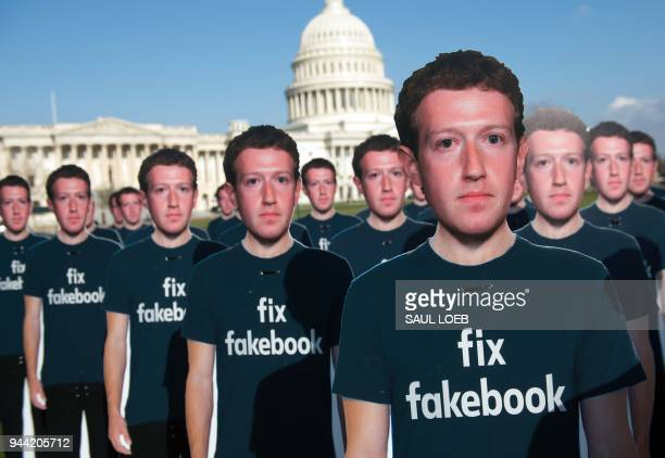 One hundred cardboard cutouts of Facebook founder and CEO Mark Zuckerberg stand outside the US Capitol in Washington DC April 10 2018 Advocacy group...