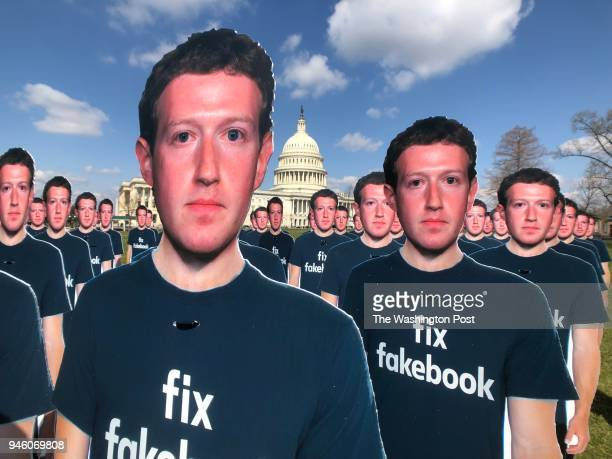 One hundred cut outs of Facebook founder Mark Zuckerberg stand on the southeast lawn of the US Capitol in Washington DC on April 10 2018 The cut outs...