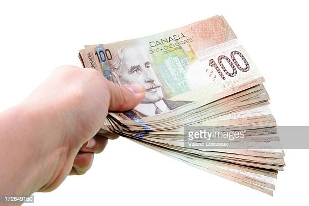 one hundred dollar bills - canadian currency stock pictures, royalty-free photos & images