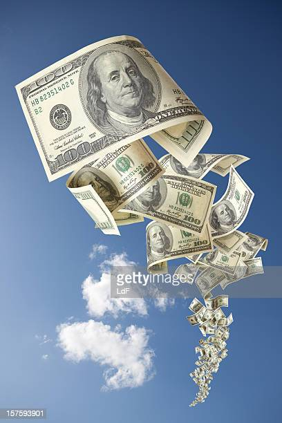 One Hundred Dollars Bill falling in the clouds