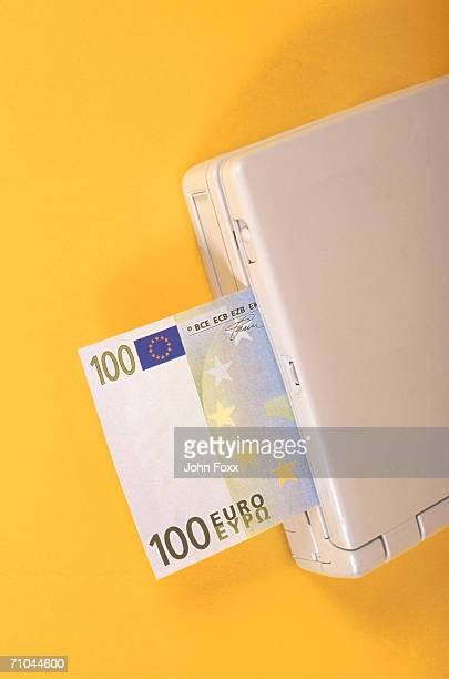 one hundred euro banknote in printer, close-up - money printer stock pictures, royalty-free photos & images