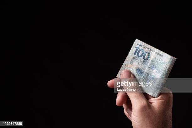 one hundred reais bill. - real people stockfoto's en -beelden