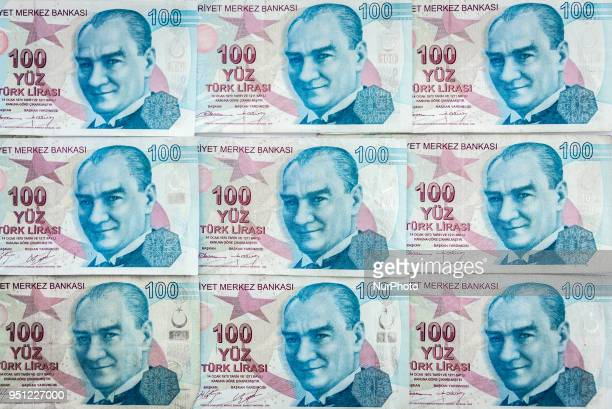 One hundred Turkish Lira banknotes showing the face of Turkey's founder Mustafa Kemal Ataturk The lira has been a volatile currency in emerging...