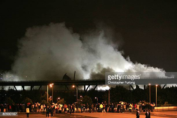 One jagged section of the the Tinsley cooling towers pertrudes above the motorway after the controlled explosion to demolish them on August 24 2008...