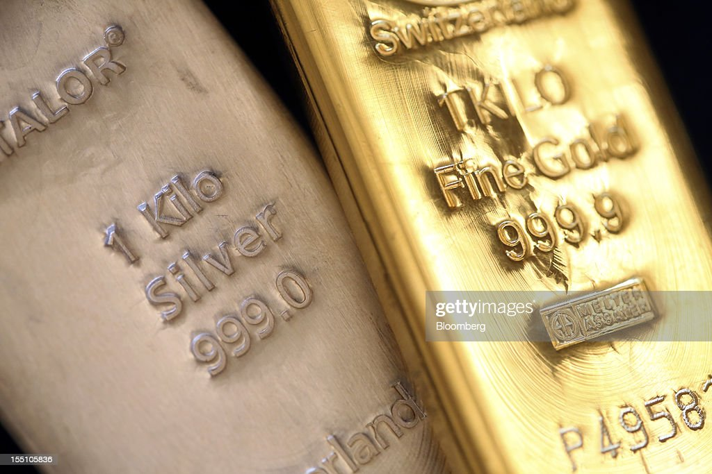 One kilogram gold and silver bars are seen in this arranged photograph at Gold Investments Ltd. bullion dealers in London, U.K., on Thursday, Nov. 1, 2012. Gold may rise for a third straight day, as China's manufacturing expanded for the first time in three months, increasing demand prospects for commodities. Photographer: Chris Ratcliffe/Bloomberg via Getty Images