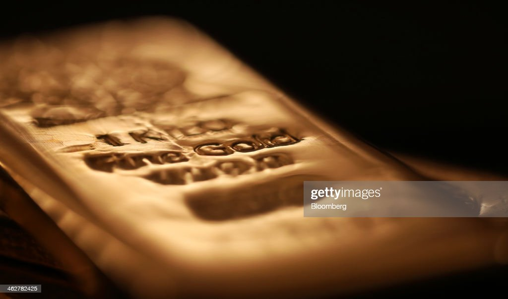 A one kilogram gold bar is seen in this arranged photograph at Gold Investments Ltd. bullion dealers in London, U.K., on Wednesday, Jan. 15, 2014. Gold futures extended a decline from a one-month high on speculation that the U.S. Federal Reserve will continue reducing stimulus, strengthening the dollar and cutting the metal's appeal as an alternative investment. Photographer: Chris Ratcliffe/Bloomberg via Getty Images
