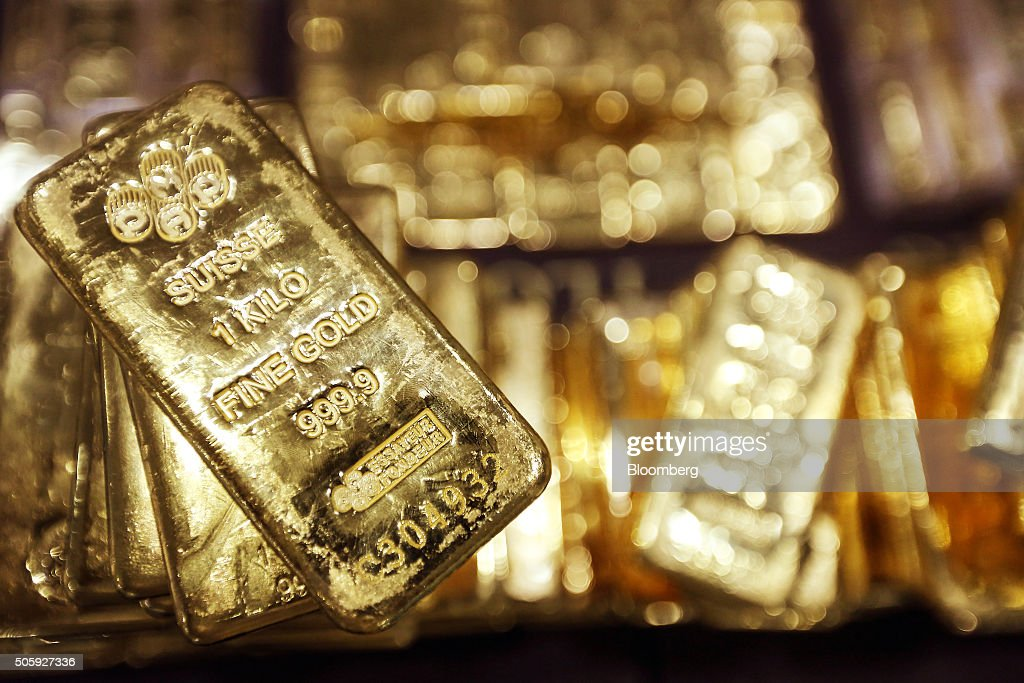 One kilogram gold bars are displayed for a photograph at the YLG Bullion International Co. headquarters in Bangkok, Thailand, on Wednesday, Jan. 13, 2016. Thailand's biggest buyer of gold will boost purchases by about 25 percent to 160 tons this year, said chief executive officer Pawan Nawawattanasub. Photographer: Dario Pignatelli/Bloomberg via Getty Images