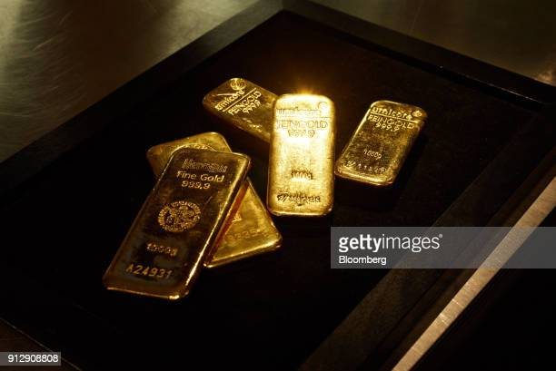 One kilogram gold bars sit in a storage tray in this arranged photograph in the precious metals deposit vaults of Pro Aurum KG in Munich Germany on...