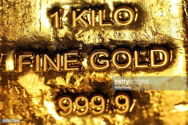 One kilogram gold bars sit in a window display at the YLG Bullion International Co headquarters in Bangkok Thailand on Wednesday Jan 13 2016...