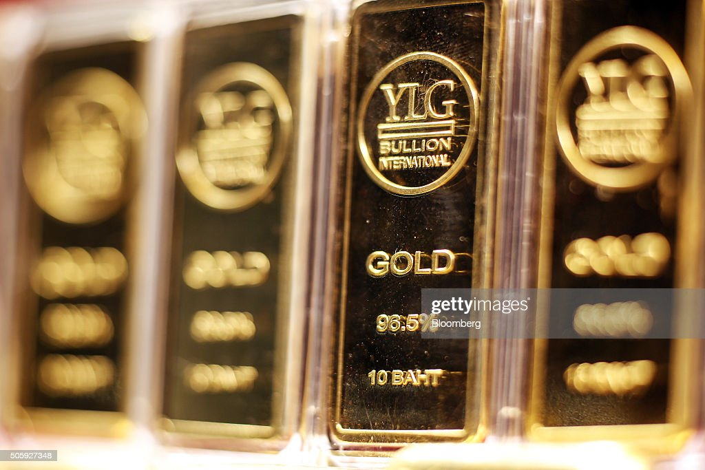 One kilogram gold bars sit in a window display at the YLG Bullion International Co. headquarters in Bangkok, Thailand, on Wednesday, Jan. 13, 2016. Thailand's biggest buyer of gold will boost purchases by about 25 percent to 160 tons this year, said chief executive officer Pawan Nawawattanasub. Photographer: Dario Pignatelli/Bloomberg via Getty Images